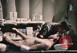 Image of wounded United States soldier Vietnam, 1969, second 58 stock footage video 65675022607
