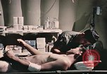 Image of wounded United States soldier Vietnam, 1969, second 59 stock footage video 65675022607
