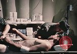 Image of wounded United States soldier Vietnam, 1969, second 60 stock footage video 65675022607