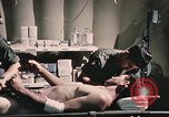 Image of wounded United States soldier Vietnam, 1969, second 61 stock footage video 65675022607