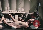 Image of wounded United States soldier Vietnam, 1969, second 62 stock footage video 65675022607