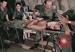 Image of wounded United States soldier Vietnam, 1969, second 6 stock footage video 65675022608