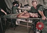 Image of wounded United States soldier Vietnam, 1969, second 7 stock footage video 65675022608