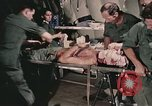 Image of wounded United States soldier Vietnam, 1969, second 8 stock footage video 65675022608