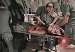 Image of wounded United States soldier Vietnam, 1969, second 11 stock footage video 65675022608