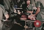 Image of wounded United States soldier Vietnam, 1969, second 12 stock footage video 65675022608