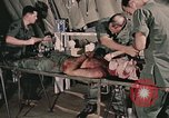 Image of wounded United States soldier Vietnam, 1969, second 13 stock footage video 65675022608