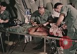 Image of wounded United States soldier Vietnam, 1969, second 14 stock footage video 65675022608