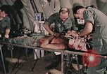 Image of wounded United States soldier Vietnam, 1969, second 15 stock footage video 65675022608