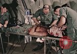 Image of wounded United States soldier Vietnam, 1969, second 17 stock footage video 65675022608