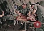Image of wounded United States soldier Vietnam, 1969, second 18 stock footage video 65675022608