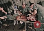 Image of wounded United States soldier Vietnam, 1969, second 19 stock footage video 65675022608
