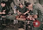 Image of wounded United States soldier Vietnam, 1969, second 21 stock footage video 65675022608
