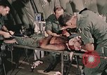 Image of wounded United States soldier Vietnam, 1969, second 23 stock footage video 65675022608