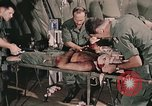 Image of wounded United States soldier Vietnam, 1969, second 24 stock footage video 65675022608