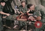 Image of wounded United States soldier Vietnam, 1969, second 25 stock footage video 65675022608