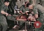 Image of wounded United States soldier Vietnam, 1969, second 26 stock footage video 65675022608