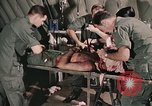 Image of wounded United States soldier Vietnam, 1969, second 27 stock footage video 65675022608
