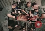 Image of wounded United States soldier Vietnam, 1969, second 29 stock footage video 65675022608