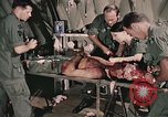 Image of wounded United States soldier Vietnam, 1969, second 30 stock footage video 65675022608