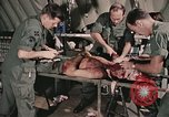 Image of wounded United States soldier Vietnam, 1969, second 31 stock footage video 65675022608