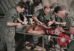 Image of wounded United States soldier Vietnam, 1969, second 32 stock footage video 65675022608