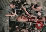 Image of wounded United States soldier Vietnam, 1969, second 33 stock footage video 65675022608