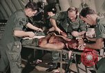 Image of wounded United States soldier Vietnam, 1969, second 34 stock footage video 65675022608