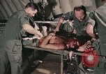Image of wounded United States soldier Vietnam, 1969, second 36 stock footage video 65675022608