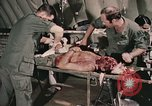 Image of wounded United States soldier Vietnam, 1969, second 37 stock footage video 65675022608