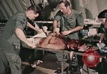 Image of wounded United States soldier Vietnam, 1969, second 38 stock footage video 65675022608