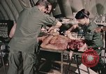Image of wounded United States soldier Vietnam, 1969, second 42 stock footage video 65675022608
