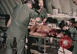 Image of wounded United States soldier Vietnam, 1969, second 43 stock footage video 65675022608