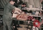 Image of wounded United States soldier Vietnam, 1969, second 44 stock footage video 65675022608