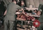Image of wounded United States soldier Vietnam, 1969, second 46 stock footage video 65675022608