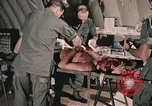 Image of wounded United States soldier Vietnam, 1969, second 47 stock footage video 65675022608