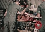 Image of wounded United States soldier Vietnam, 1969, second 48 stock footage video 65675022608