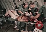 Image of wounded United States soldier Vietnam, 1969, second 57 stock footage video 65675022608
