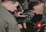 Image of wounded United States soldier Vietnam, 1969, second 58 stock footage video 65675022608