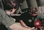 Image of wounded United States soldier Vietnam, 1969, second 60 stock footage video 65675022608