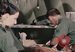 Image of wounded United States soldier Vietnam, 1969, second 62 stock footage video 65675022608