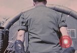 Image of wounded United States soldier Vietnam, 1969, second 14 stock footage video 65675022609