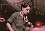 Image of wounded United States soldier Vietnam, 1969, second 34 stock footage video 65675022609