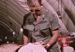 Image of wounded United States soldier Vietnam, 1969, second 42 stock footage video 65675022609