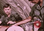 Image of wounded United States soldier Vietnam, 1969, second 48 stock footage video 65675022609