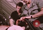 Image of wounded United States soldier Vietnam, 1969, second 51 stock footage video 65675022609