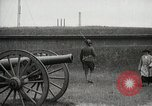 Image of US Army soldier shows cannon to woman United States USA, 1916, second 3 stock footage video 65675022633