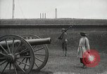 Image of US Army soldier shows cannon to woman United States USA, 1916, second 7 stock footage video 65675022633