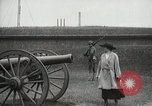 Image of US Army soldier shows cannon to woman United States USA, 1916, second 9 stock footage video 65675022633