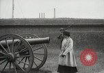 Image of US Army soldier shows cannon to woman United States USA, 1916, second 10 stock footage video 65675022633